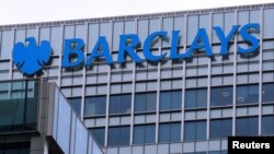 FILE - The logo of Barclays bank is seen at its office in the Canary Wharf business district of London, April 1, 2013.