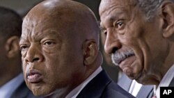 Rep. John Lewis, D-Ga., left, and Rep. John Conyers, D-Mich., right, co-chairs of the Civil Rights Taskforce of the Congressional Black Caucus, join other members of the House to express disappointment in the Supreme Court's decision on Shelby County v. H