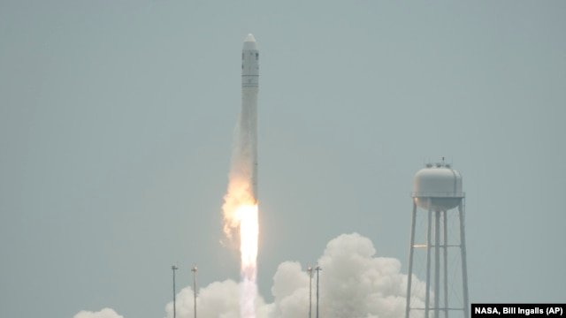 The Orbital Sciences Corporation Antares rocket launches with the Cygnus spacecraft on board from NASA's Wallops Flight Facility on Wallops Island, Virginia, July 13, 2014.