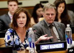 Fred Warmbier, right, listens as Cindy Warmbier speaks of their son Otto Warmbier, an American who died last year, days after his release from captivity in North Korea, May 3, 2018, at the U.N.