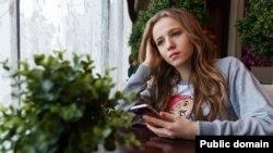 Teen girl sad cell phone social media