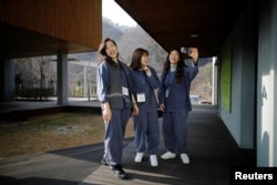 Park Hye-ri (L), 28, a startup business program manager, takes a selfie with her friends before being locked up at Prison Inside Me, a mock prison facility, in Hongcheon, South Korea, November 10, 2018. (REUTERS/Kim Hong-Ji)