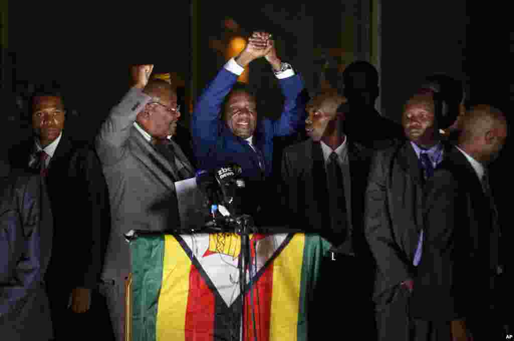 Zimbabwe's President in waiting Emmerson Mnangagwa greets supporters gathered outside the Zanu-PF party headquarters in Harare.