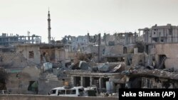 FILE - After Islamic State extremists swept into Kobani in mid-September, Kurdish fighters and U.S.-led airstrikes fought to reclaim it. The Syrian town bears battle scars, as shown Nov. 19, 2014.