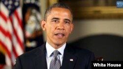 President Barack Obama is seen delivering his weekly address in this White House video screen grab.