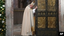 FILE - Pope Francis closes the Holy Door of St. Peter's Basilica at the Vatican, Nov. 20, 2016.