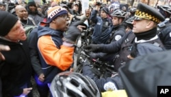 FILE - Protesters confront Chicago police during a march against police violence in Chicago, Illinois, Dec. 24, 2015.