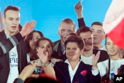 Beata Szydlo, candidate for prime minister of the conservative opposition Law and Justice party in Poland's general elections Sunday celebrates with supporters at a party convention in Warsaw, Oct. 22, 2015. (AP Photo/Czarek Sokolowski)