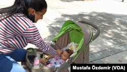A mother with her baby in Venezuela.