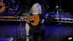 FILE - Stella Parton performs at The Beck Theatre in London, March 8, 2016.