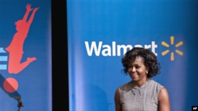 First lady Michelle Obama arrives for a Wal-Mart announcement of a comprehensive effort to provide healthier and more affordable food choices to their customers, Jan. 20, 2011, in Washington.