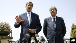 U.S. Secretary of State John Kerry, left, is flanked by Italian Foreign Minister Paolo Gentiloni, during a press conference that followed their meeting in Rome, June 26, 2016.