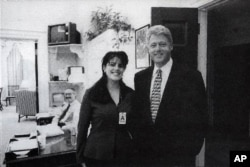 FILE - Official White House photo from Independent Counsel Kenneth Starr's report on Clinton, showing the president and Monica Lewinsky at the White House in 1995.