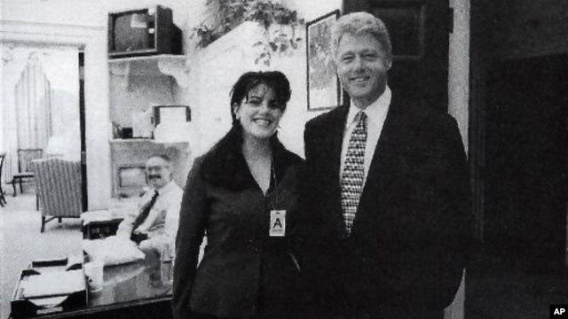 FILE - Official White House photo from page 3179 of Independent Counsel Kenneth Starr's report on President Clinton, showing the president and Monica Lewinsky at the White House, taken Nov. 17, 1995.