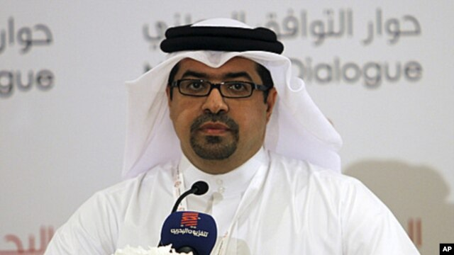 Isa Abdul Rahman, spokesperson for Bahrain's National Dialogue Committee, speaks during a news conference held after the inauguration of the national dialogue in Manama, July 2, 2011