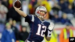 New England Patriots quarterback Tom Brady (12) throws during the first half of the NFL football AFC Championship.
