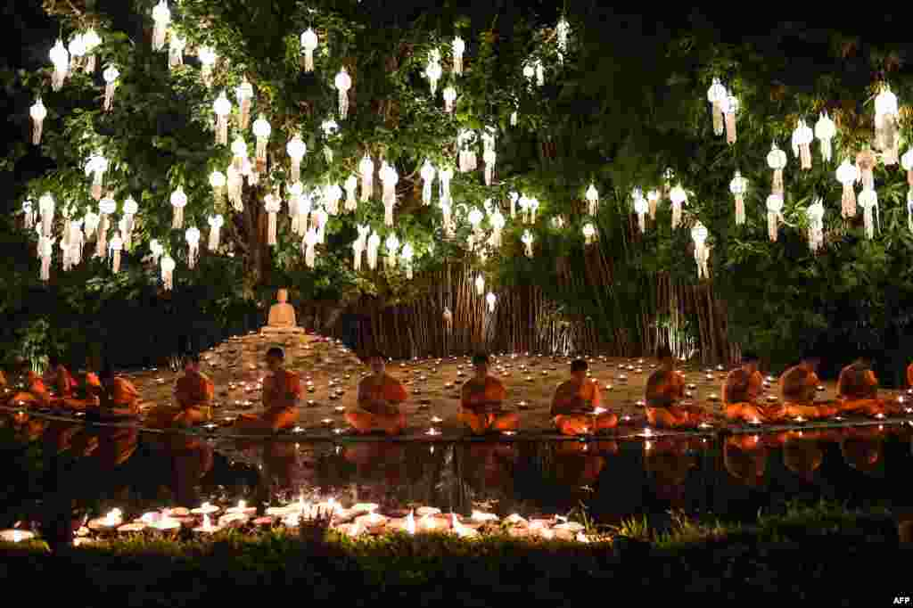 Novice Buddhist monks pray at Wat Phan Tao temple to mark the beginning of the annual Yi Peng festival in the popular tourist city of Chiang Mai in the north of Thailand.