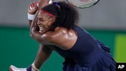 Serena Williams of the United States returns to Elina Svitolina of Ukraine at the 2016 Summer Olympics in Rio de Janeiro, Brazil, Aug. 9, 2016.