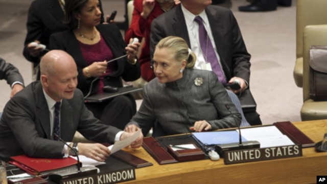 United States Secretary of State Hillary Rodham Clinton, right, speaks to United Kingdom Foreign Secretary William Hague before a UN Security Council meeting on the situation in Syria,  Tuesday, Jan. 31, 2012.