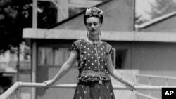 FILE - In this April 14, 1939 file photo, Mexican painter and surrealist Frida Kahlo poses at her home in Mexico City.