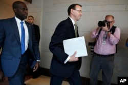 Deputy Attorney General Rod Rosenstein arrives on Capitol Hill in Washington, May 18, 2017, for a closed-door meeting with Senators.