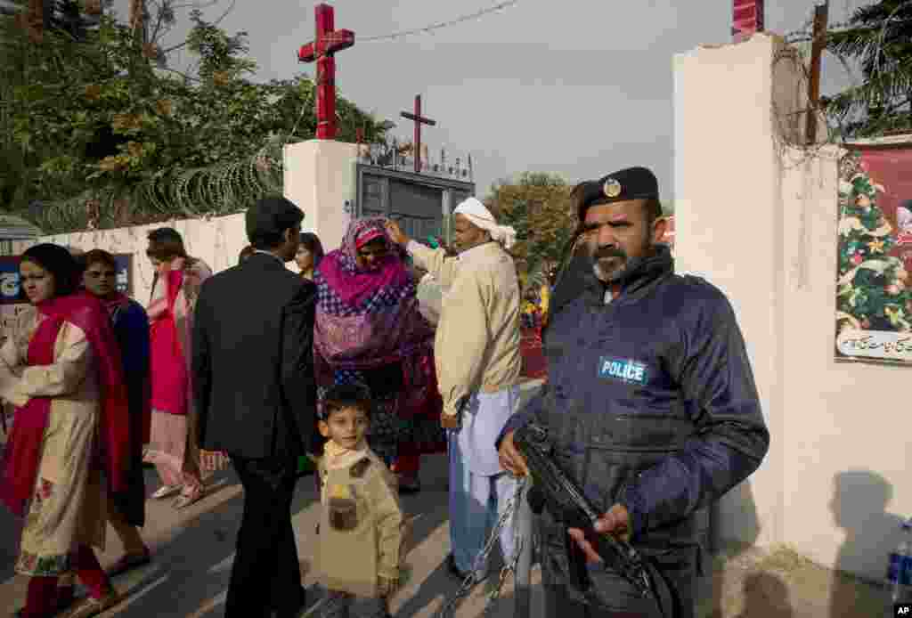 People from Pakistani Christian community leave a local church after attending Christmas mass at a local church, under security, in Islamabad, Pakistan, Dec. 25, 2015.