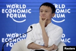 """FILE - Chairman and chief executive of Alibaba Group Jack Ma reacts during a session of """"Future-Proofing the Internet Economy"""" at the World Economic Forum (WEF) in China's port city Dalian, September 9, 2015."""