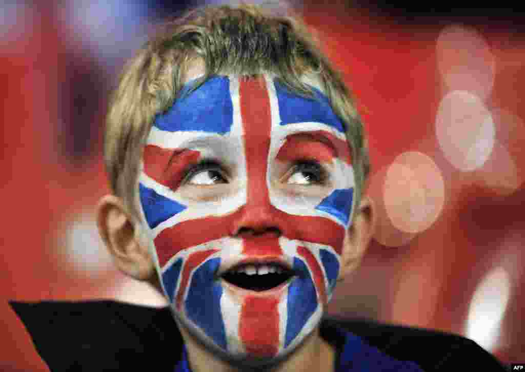A young Great Britain fan enjoys the atmosphere before the London 2012 Olympic Games men's quarter-final football match between Great Britain and South Korea at the Millennium Stadium in Cardiff, Wales on August 4, 2012.