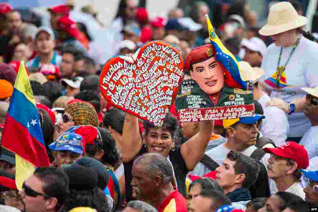 Supporters of Venezuelan President Nicolas Maduro wait for him during a rally to commemorate the 57th anniversary of the end of Venezuelan dictator Marcos Perez Jimenez's regime, in Caracas.