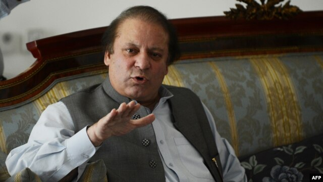 Pakistan's incoming prime minister Nawaz Sharif speaks to journalists at his farm house in Raiwind on the outskirts of Lahore, May 13, 2013.