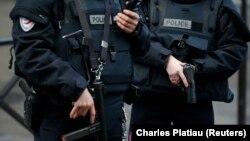 FILE - French police stand guard in Paris, France, Jan. 7, 2016.