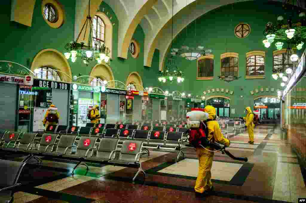 Servicemen of Russia's Emergencies Ministry wearing protective gear disinfect Moscow's Kazansky railway station, as the country adopts measures to curb the spread of the COVID-19.