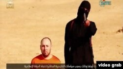 Militant group Islamic State releases video it says shows the execution of US reporter Steven Sotloff.