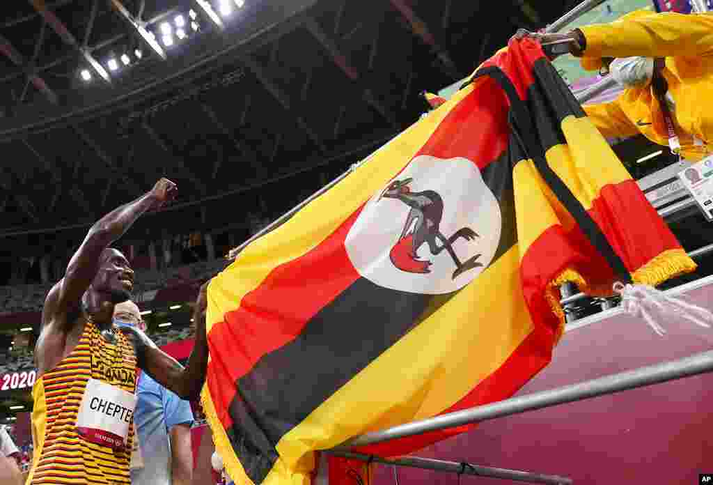 Joshua Cheptegei, of Uganda celebrates after winning the gold medal in the final of the men's 5,000-meters at the 2020 Summer Olympics, Friday, Aug. 6, 2021, in Tokyo, Japan. (AP Photo/Charlie Riedel)