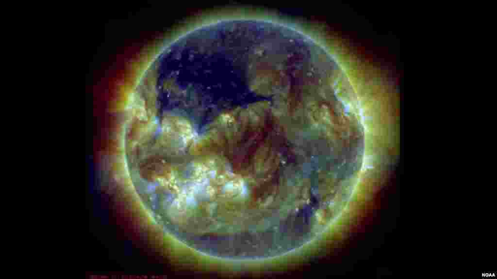 A coronal hole on the sun, seen here in dark blue, is an area of the sun's atmosphere, the corona, where the magnetic field opens up and the material flows quickly out. (Photo: NOAA Space Weather Prediction Center)