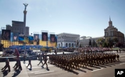 Ukrainian army soldiers march on Khreshchatyk street during military parade on the occasion of Ukraine's Independence Day in the capital Kyiv, Ukraine, Monday, Aug. 24, 2015.