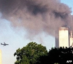 A second hijacked plane flies toward the World Trade Center