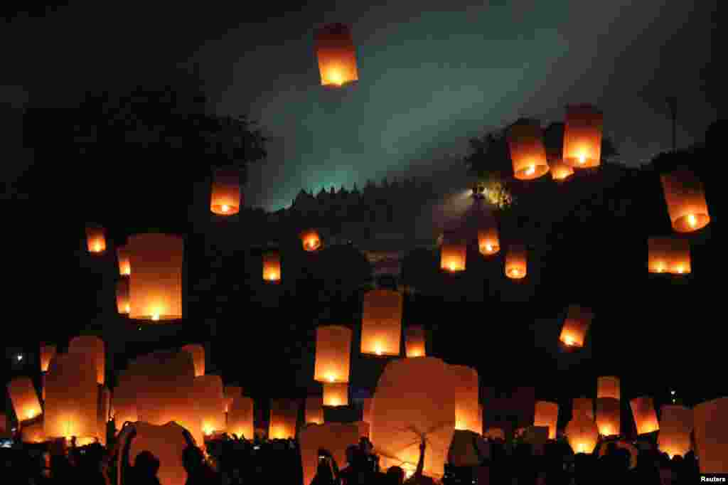 People release lanterns to mark the Buddhist celebration of Vesak at Borobudur temple in Magelang, Central Java, Indonesia, May 21, 2016, in this photo taken by Antara Foto.
