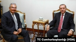 Turkish President Recep Tayyip Erdogan meets the former leader of the Republican People's Party, Deniz Baykal, at the presidential palace in Ankara, June 10, 2015.
