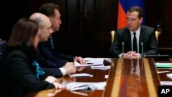 Russian Prime Minister Dmitry Medvedev chairs a government meeting on ways to shore up the plummeting ruble, Dec. 16, 2014.