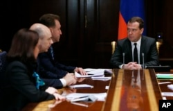 FILE - Russian Prime Minister Dmitry Medvedev chairs a government meeting in the Gorki residence outside Moscow on ways to shore up the plummeting ruble, Dec. 16, 2014.