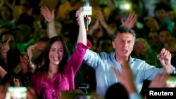 FILE - Mauricio Macri, presidential candidate of the Cambiemos alliance, and Maria Eugenia Vidal, Buenos Aires province governor-elect, appear at a rally in Lanus on the outskirts of Buenos Aires, Oct. 21, 2015.