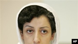 Iranian Narges Mohammadi, delegate of the Center for Human Rights Defenders, listens to a question during a press conference on the Assessment of the Human Rights Situation in Iran, at the UN headquarters in Geneva, Switzerland, Monday, June 9, 2008. (AP