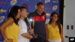 U.S. midfielder Jermaine Jones, with 'Man of the Match' trophy - He scored the first U.S. goal