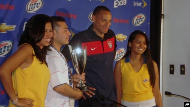 U.S. midfielder Jermaine Jones, with 'Man of the Match' trophy - He scored the first U.S. goal