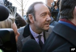 FILE - Actor Kevin Spacey arrives at district court, Jan. 7, 2019 in Nantucket, Massachusetts, to be arraigned on a charge of indecent assault and battery.