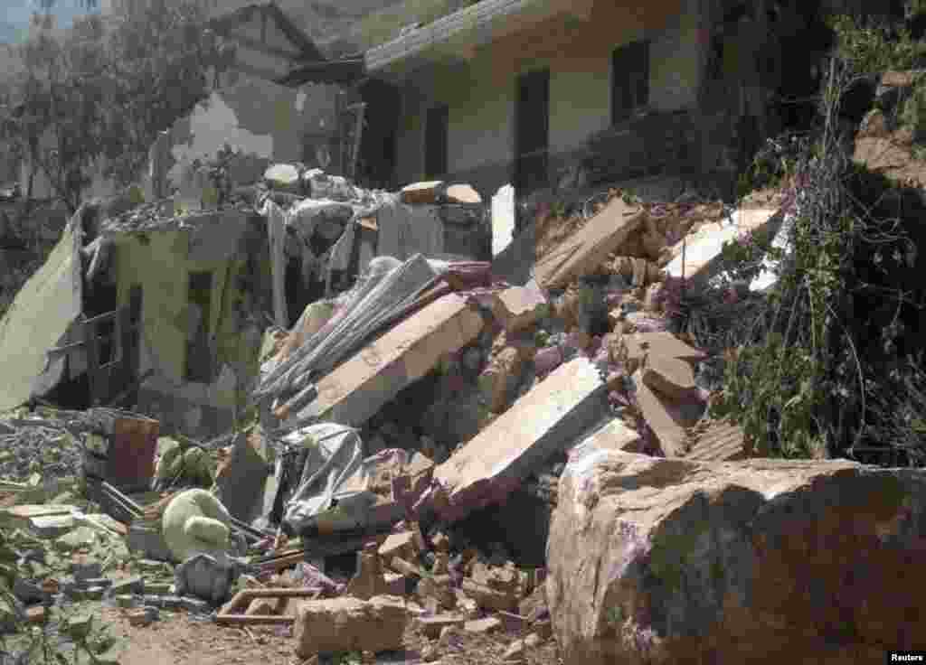 Two shallow 5.6 magnitude earthquakes hit southwestern China on Friday, killing at least 64 people and forcing tens of thousands of people from damaged buildings, Sept. 7, 2012.
