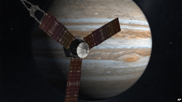 This NASA image shows an artist rendering of the Juno spacecraft circling Jupiter.