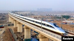 FILE - A high-speed train travelling to Guangzhou is seen running on Yongdinghe Bridge in Beijing.