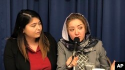 Mihrigul Tursun, right, speaks at a event at the National Press Club in Washington, Monday, Nov. 26, 2018.